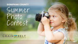 Little girl looking through camera at Summer Photo Contest text